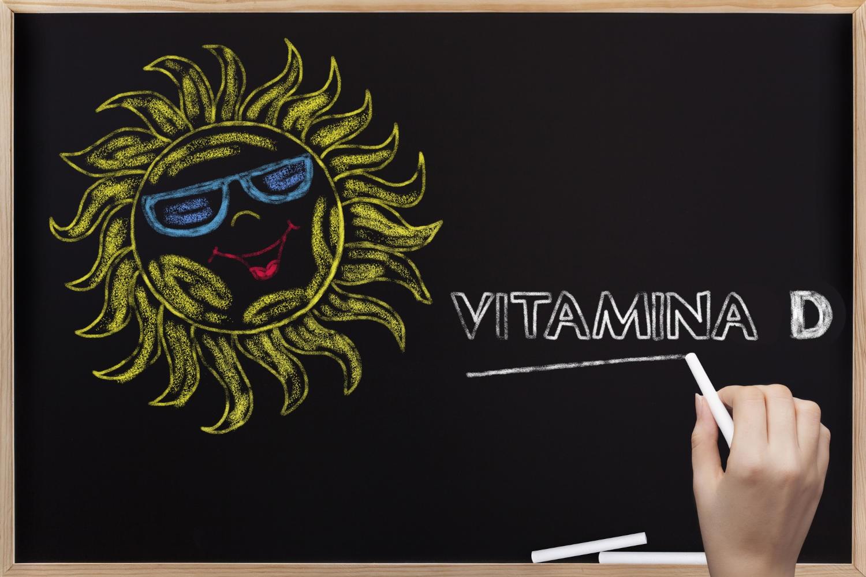 Disegno su una lavagna, con il sole e la scritta vitamina D